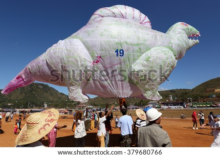 TAUNGGYI - MYANMAR - NOVEMBER 22, 2015: Unidentified Buddhist people attending the famous annual hot-air ballon festival at full moon on November 22, 2015 in Taunggyi, Myanmar. - stock photo