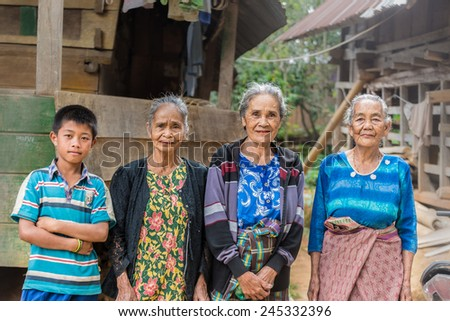 Taupe, Sulawesi, Indonesia - August 16, 2014: Portrait of Toraja senior and young people in the village of Taupe, Mamasa region, West Tana Toraja, Sulawesi, Indonesia. - stock photo