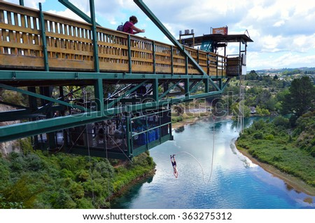 TAUPO, NZL - JAN 14 2016:Person during bungy jump from 47 metres (154 feet) in above the Waikato River in Taupo, New Zealand. - stock photo