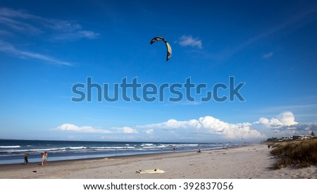 TAURANGA, NEW ZEALAND - JAN 7; People enjoying a summer day outdoors sunbathing and swimming at beach on January 7, 2015 at Mount Maunganui Beach, near Tauranga in New Zealand. - stock photo
