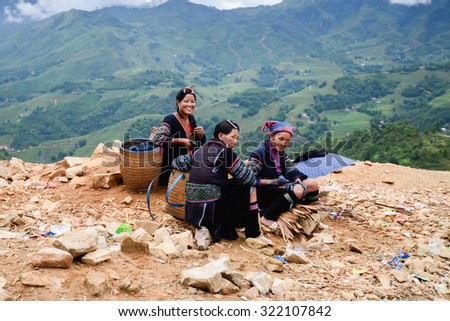 Tavan Village, Sa Pa, Vietnam - 30 July, 2015: Local women in Sa Pa, Vietnam met by the roadside to Tavan village.
