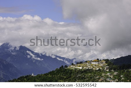 Tawang, Arunachal Pradesh, India. Ancient Buddhist Monastery set against high Himalayan peaks and overlooking the town on a bright sunny day in Tawang, Arunachal Pradesh, India.