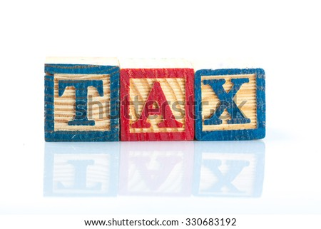Tax Concept with wooden block