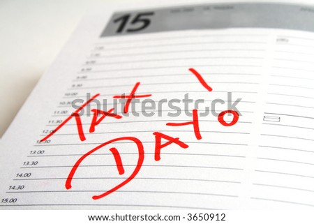 Tax day written in red into an agenda - stock photo