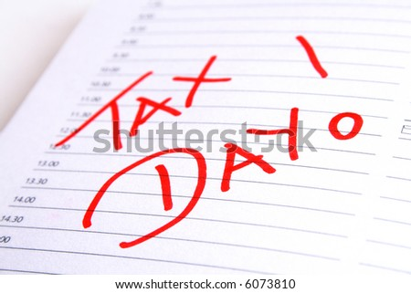 Tax day written in red into an agenda