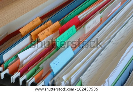 Tax files in a filing cabinet drawer - stock photo
