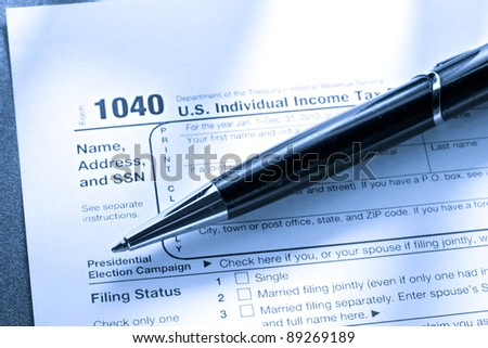 Tax form and a pen - stock photo