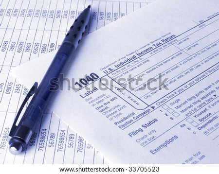 Tax form 1040 and pen. Toned blue. Shallow DOF. - stock photo