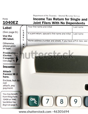 Tax form EZ with calculator - vertical image - stock photo