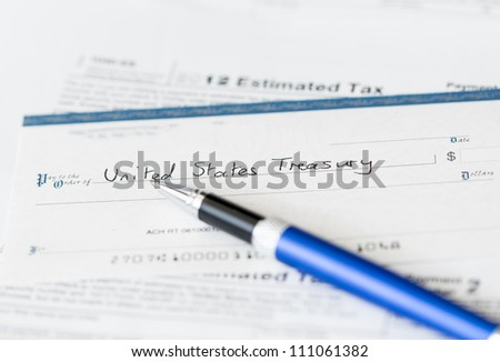 Tax form 1040 for tax year 2012 for US individual tax return with pen and check - stock photo