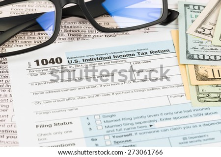 Tax form with glasses, and banknote taxation concept - stock photo
