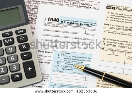 Tax form with pen, and calculator taxation concept - stock photo