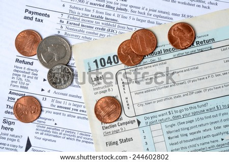tax forms and coins tax concept background - stock photo