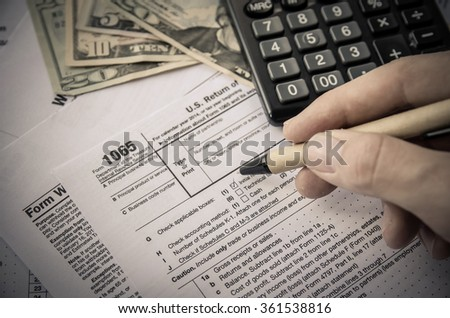 Tax forms 1065. toned image - stock photo