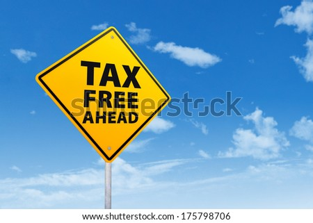 Tax free zone with sign post under blue sky - stock photo