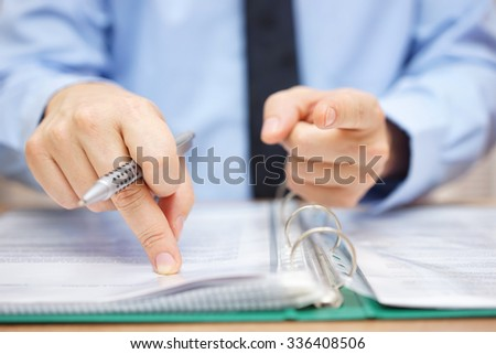 Tax inspector is pointing to you, tax evasion concept - stock photo