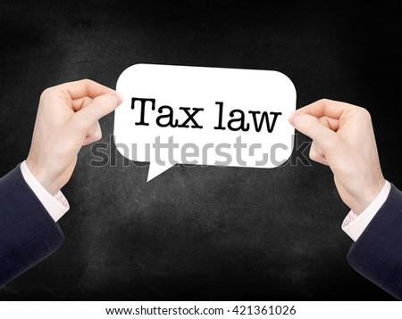 Tax law written on a speechbubble - stock photo