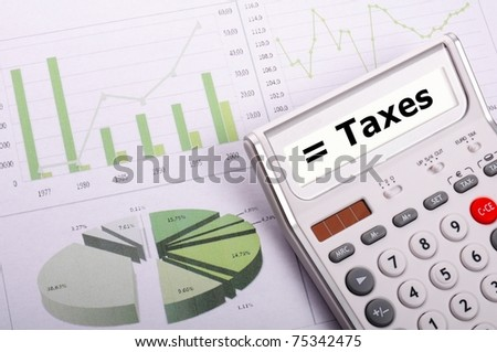tax or taxes concept with business calculator and word - stock photo