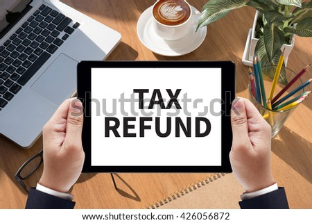 TAX REFUND Businessman work  on tablet on screen - stock photo
