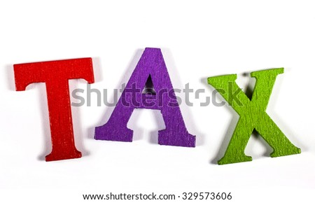 TAX spelt out with bright coloured letters over a white background. - stock photo