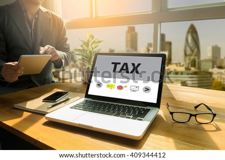 TAX    Thoughtful male person looking to the digital tablet screen, laptop screen,Silhouette and filter sun - stock photo