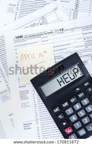 Tax time concept with an Official USA tax form, calculator, and the day tax april 15