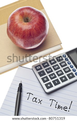 Tax Time Concept with Note on Paper with Calculator, Book and Apple. - stock photo