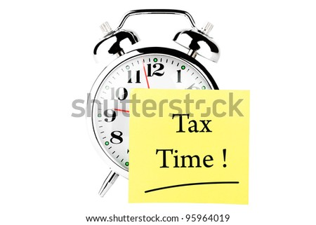 Tax time on the alarm clock face on the white background - stock photo