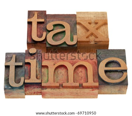 tax time words in vintage wooden letterpress printing blocks, stained by color inks, isolated on white
