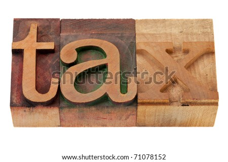 tax word in vintage wooden letterpress printing blocks, stained by color inks, isolated on white