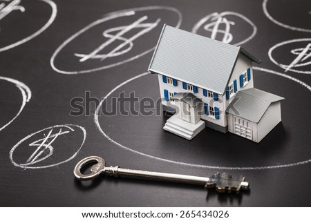 Taxes. House bubble boom presentation on chalkboard. Concept photo of Real estate market bubble , booming, money,price, rent, grid, home, house, housing, industry and subprime mortgage crisis. (Copy - stock photo