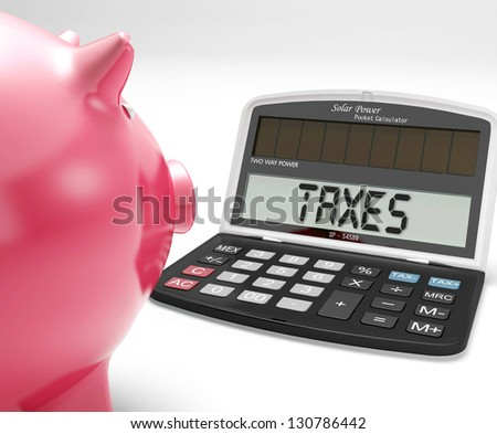 Taxes On Calculator Showing Income Tax Return