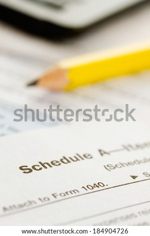 Taxes: Pencil and Schedule A From United States Tax Forms