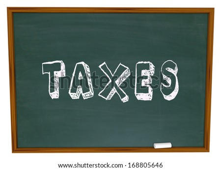 Taxes Word Chalkboard Figuring Taxation Income Tax Return - stock photo