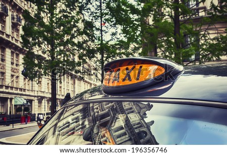 taxi cab by London street - stock photo