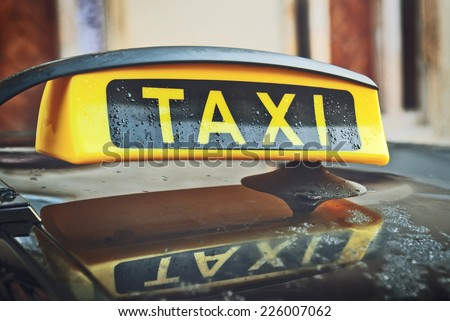 Taxi Cab Car Roof Sign Close Up with selective focus - stock photo