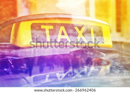 Taxi Cab Car Roof Sign Close Up with selective focus, Double Exposure - stock photo