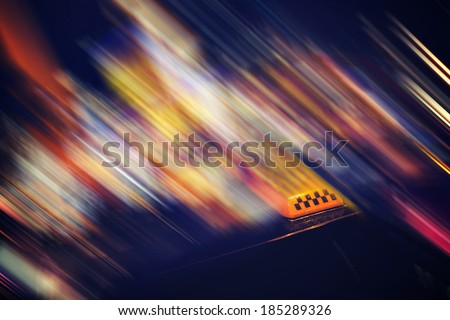 taxi car in city at night, motion blur - stock photo