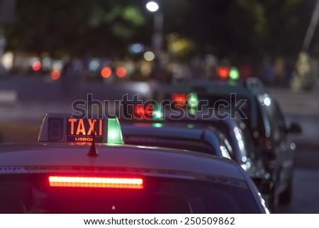 Taxi car, Lisbon - selective focus - stock photo