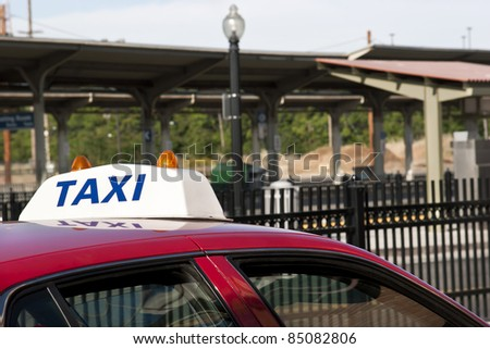 Taxi car waits for a pickup at the train stop. - stock photo