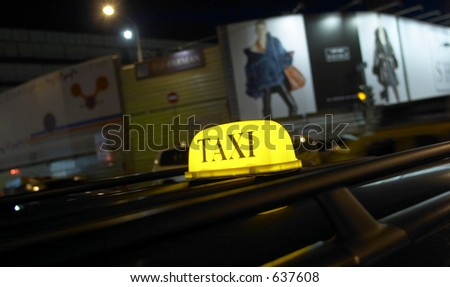 TAXI in night city - stock photo