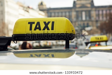 Taxi road sign with thumb-up symbol on it - stock photo