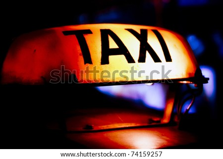taxi sign at night - stock photo