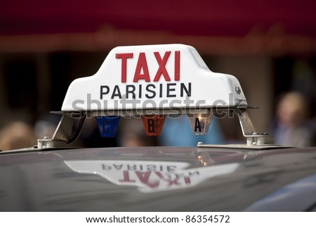 Taxi sign on a cab in Montmartre, Paris - stock photo