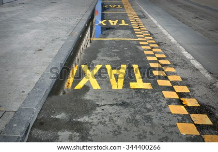 TAXI - sign on the road