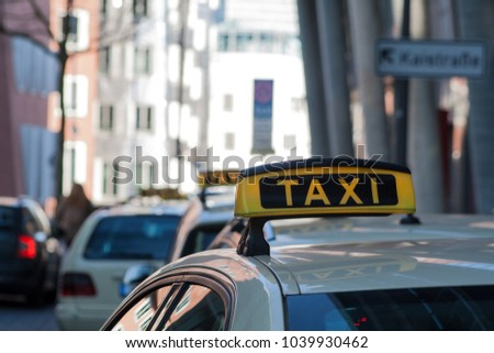 Taxis are waiting for passengers and passengers in Duesseldorf