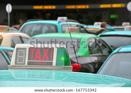 Taxis at the airport of Lisbon, Portugal - stock photo
