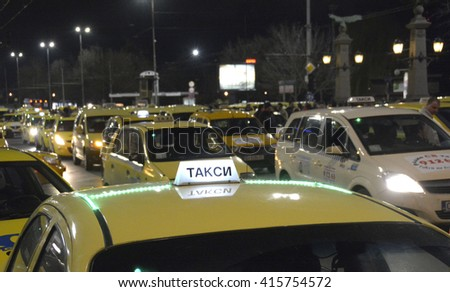 Taxis block the center at 24 March, 2016 in Sofia, Bulgaria. Taxi drivers protest against illegal passenger transport companies, feraing their daily work and life