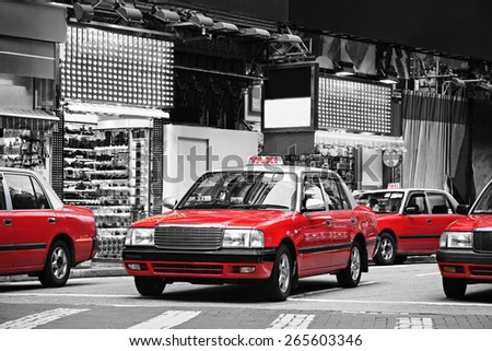 Taxis on the street in Hong Kong. Over 90% daily travelers use public transport, its the highest rank in the world. - stock photo