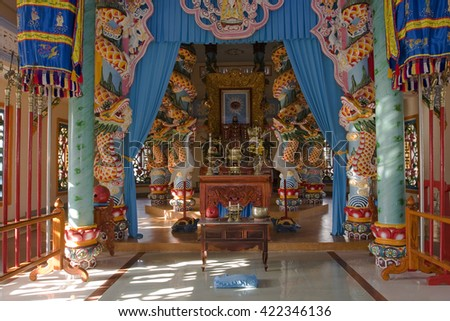 TAY NINH, VIETNAM - APRIL 19, 2016:Portico and altar in the sanctuary inside the Cao Dai Temple, Tay Ninh, Vietnam, Asia